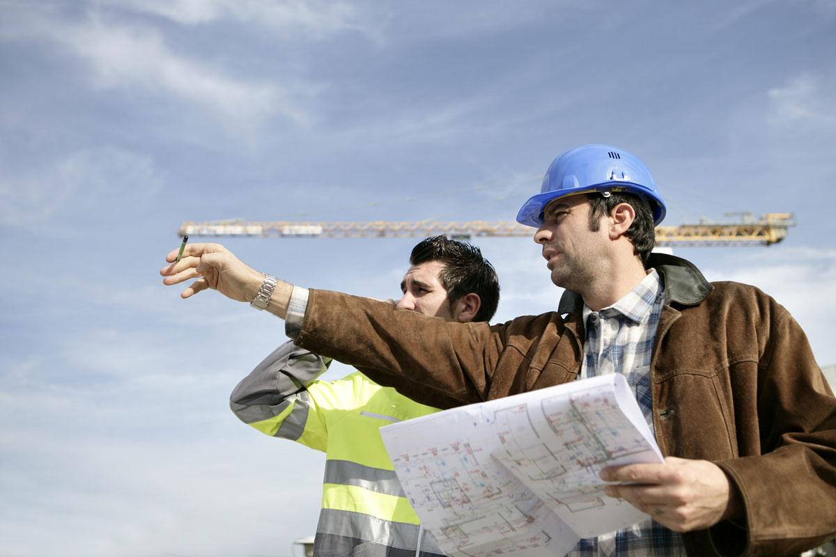 Storee Construction crew reviewing commercial construction blueprints