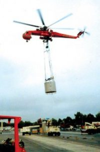 Helicopter Hauling a Catch Basin