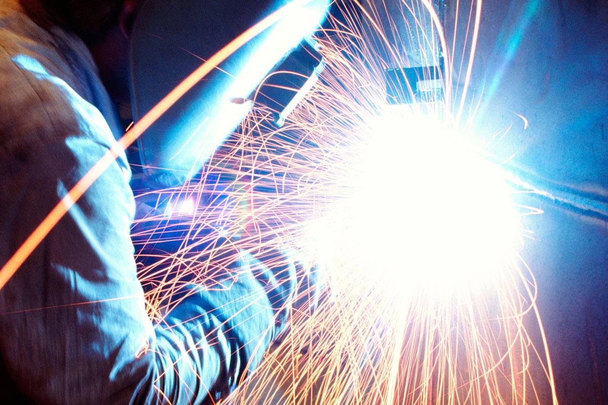 A Storee Construction metal fabricator arc welding on site