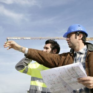 Industrial Electrical Contractors Reviewing Job Site