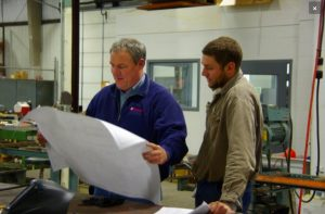 Metal Fabrication Contractor reviewing project plans